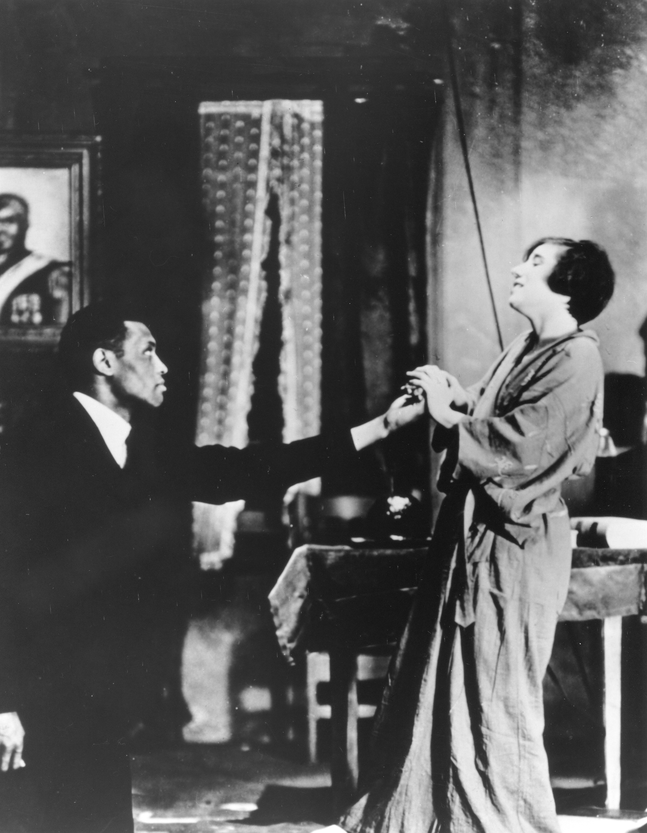 Scene in O'Neill's All God's Chillun' Got Wings in which Paul Robeson kissed Mary Blair's hand and created a national uproar. (1931)